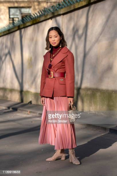 Digital influencer Aimee Song wears all Dior on February 26, 2019 in Paris, France.