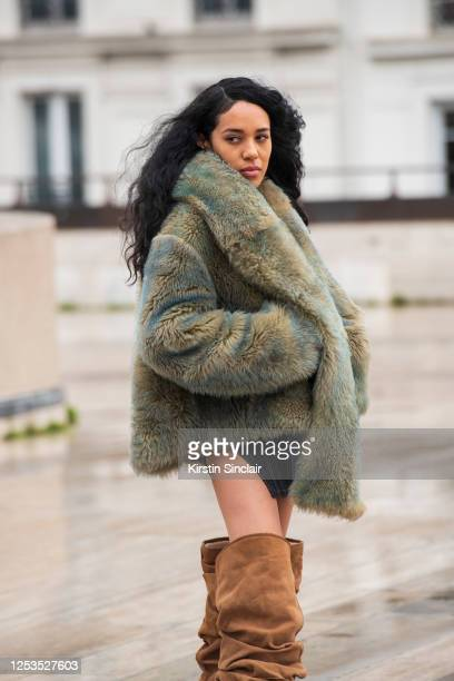 Digital influencer Aleali May wears Ugg for Y-Project boots, Fenty skirt, Misbhv top and a Eckhaus Latta for Ugg coat on March 02, 2020 in Paris,...