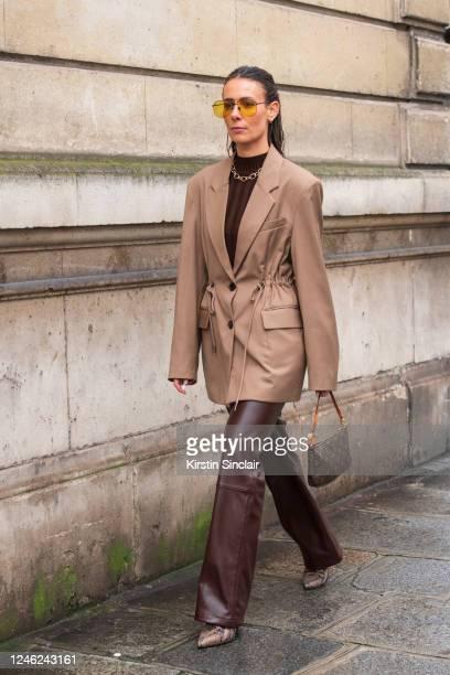 Digital influencer Alice Barbier wears Freelance shoes, Louis Vuitton bag, The Frankie Shop jacket and trousers, Projekt Produkt sunglasses on...