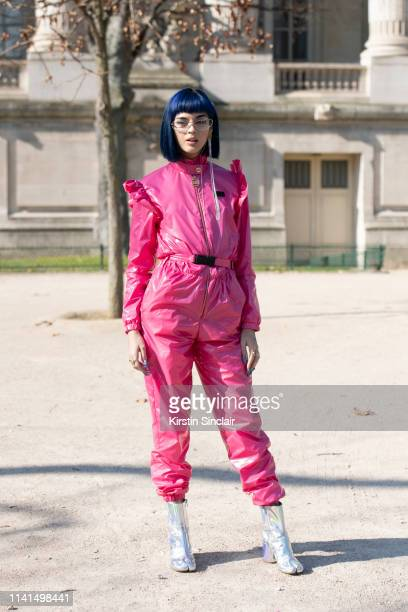 Digital Influencer and DJ Sita Abellan wears GCDS jumpsuit, clear wrap around glasses and Margiela shoes on February 27, 2019 in Paris, France.
