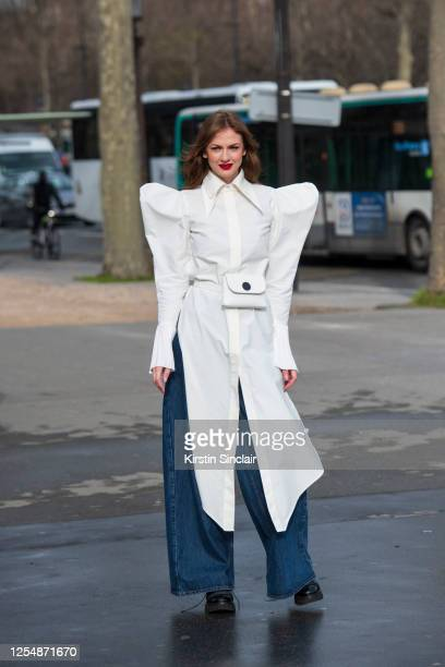 Digital influencer and Editor-in-chief at Modic magazine Julie Ianc wears a Chaotic clothing top, Laura Olaru belt bag, BLCV jeans and Gemelli boots...