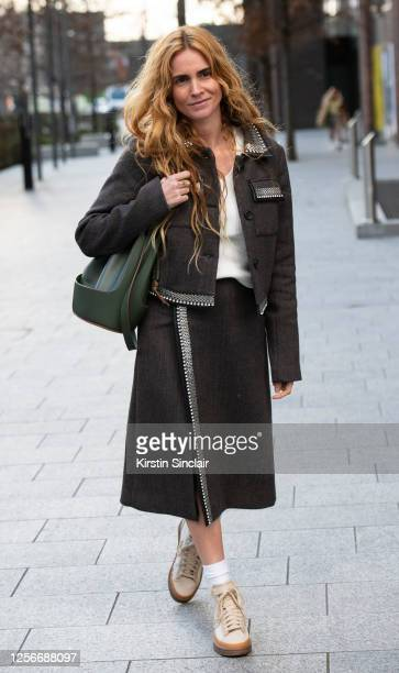 Digital Influencer and fashion director Blanca Miró Scrimieri wears a Christopher Kane jacket and skirt, Loewe bag and Converse trainers during...