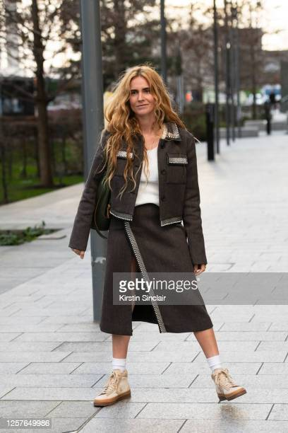 Digital Influencer and fashion director Blanca Miró Scrimieri wears a Christopher Kane jacket and skirt, Loewe bag, white T shirt and Converse...
