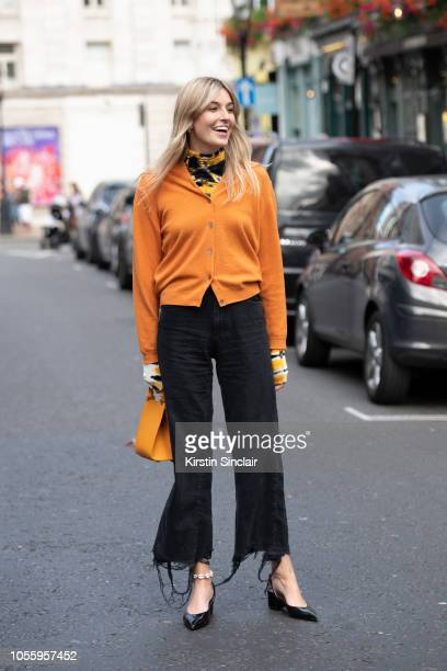 Digital influencer and fashion journalist Camille Charriere wears a Charles and Keith bag Mango shoes Proenza Schouler turtle neck sweater Orange...
