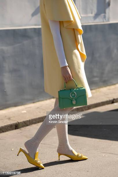 Digital Influencer and founder of SDR Samantha de Reviziis wears an Albino Teodoro dress Giannico shoes and Aigner bag on February 26 2019 in Paris...