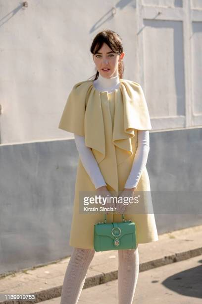 Digital Influencer and founder of SDR Samantha de Reviziis wears an Albino Teodoro dress and an Aigner bag on February 26 2019 in Paris France