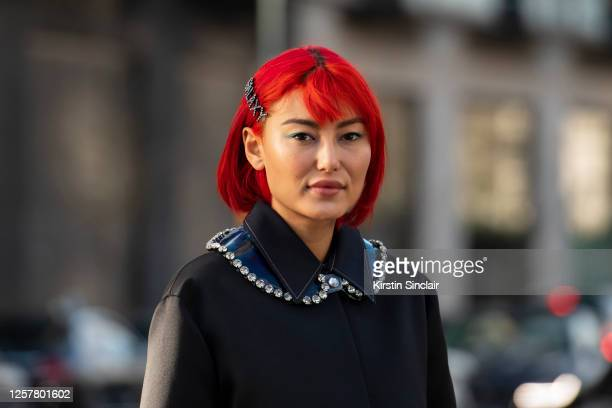 Digital influencer and model Amalie Gassman wears a Christopher Kane jacket and a galaxy diamante hair clip during London Fashion Week February 2020...