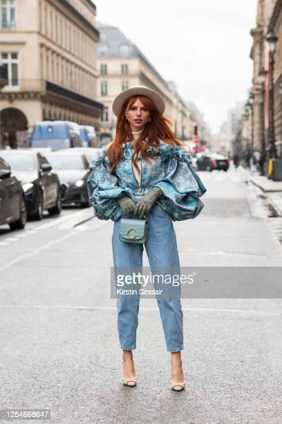 Digital influencer and model Evelyn Kazantzoglou wears a Natar Georgio jacket, Chloe bag, Fendi shoes, Zara jeans and a custom hat on March 02, 2020...