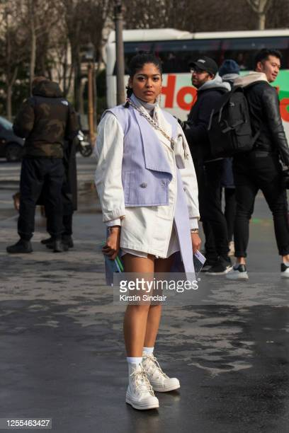 Digital influencer and model Jenna Bey wears all Chanel with Ambush and Converse trainers on March 03, 2020 in Paris, France.
