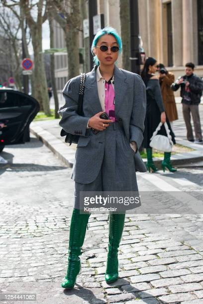 Digital influencer and Photographer Margaret Zhang wears all Miu Miu with a Prada bag, Quay sunglasses and blue hair on March 03, 2020 in Paris,...