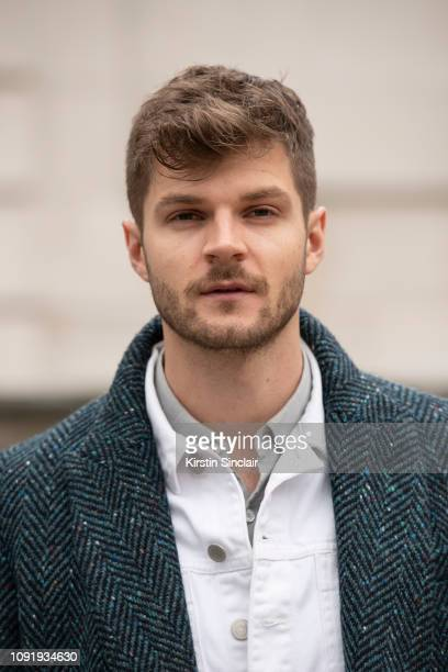 Digital Influencer and Vlogger Jim Chapman wears a Burberry coat and a Whistles jacket during London Fashion Week Men's January 2019 on January 07...