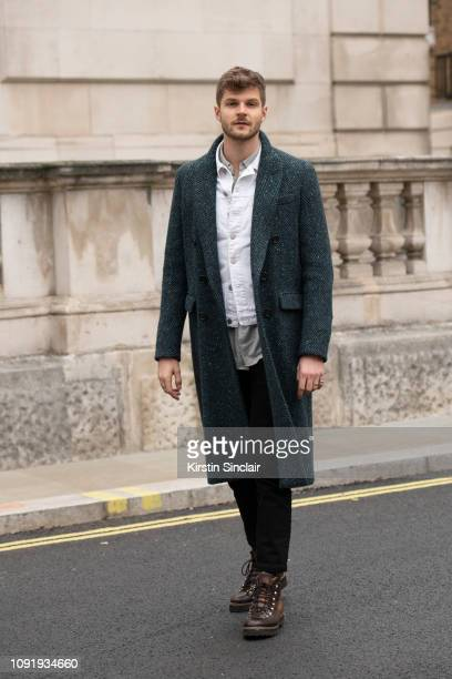 Digital Influencer and Vlogger Jim Chapman wears Levi's jeans Burberry coat Whistles jacket and Ralph Lauren boots during London Fashion Week Men's...