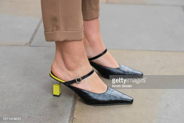 Digital influencer Andreea Cristea wears HM trousers and Yuul Yie shoes during London Fashion Week February 2020 on February 18 2020 in London England