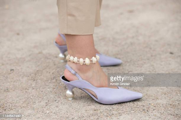 Digital Influencer Andreea Cristea wears Yuul Yie shoes and Dorothee Schumacher trousers on February 28 2019 in Paris France