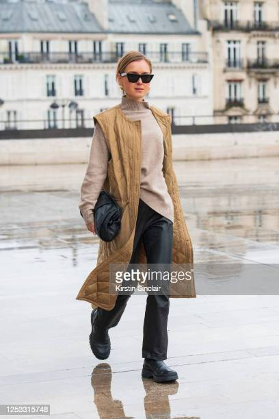Digital influencer Anna Borisnova wears an Arket gilet, bag and boots, Celine sunglasses, Massimo Dutti jumper and Inwear trousers on March 02, 2020...