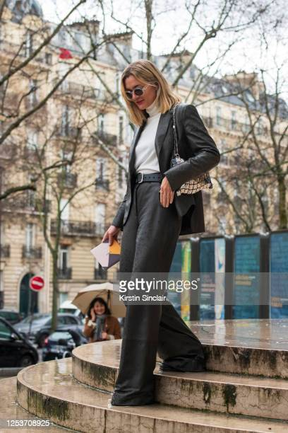 Digital influencer Anne Laure Mais Adenorah wears all Akris and a Paco Rabanne bag on March 02 2020 in Paris France
