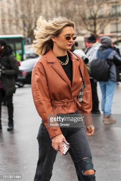 Digital influencer Anne Laure Mais wears Jonathan Simkhai jacket Levis jeans on February 27 2020 in Paris France