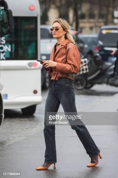 Digital influencer Anne Laure Mais wears Jonathan Simkhai jacket Levis jeans Manu Atelier shoes on February 27 2020 in Paris France