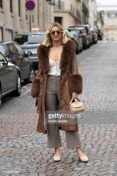 Digital Influencer AnneLaure Mais Moreau Adenorah wears a Saks Potts coat Iblues trousers and Amelie Pichard bag on March 02 2019 in Paris France