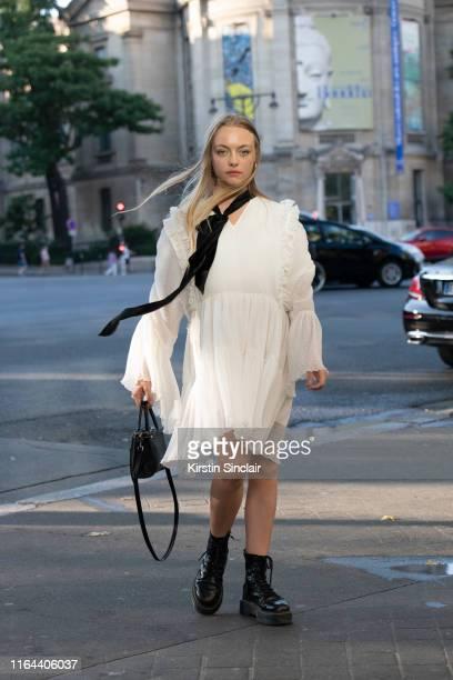 Digital influencer Anouchka Gautier wears Dr Martens boots, Balenciaga bag and vintage dress on July 01, 2019 in Paris, France.