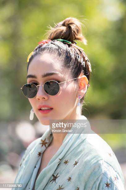 Digital influencer Araya Alberta Hargate wears a Gucci dress and Chopard earrings on July 03 2019 in Paris France