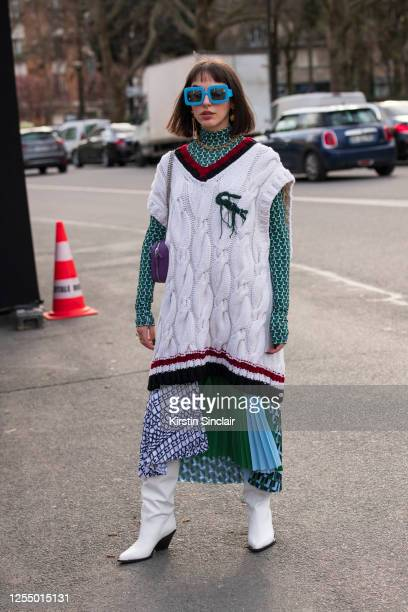 Digital influencer Barbara Malewicz wears all Lacoste with Barbara Bui boots and Courreges sunglasses on March 03, 2020 in Paris, France.