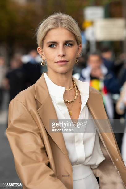 Digital influencer Caroline Daur wears a Regne Fils jacket and Ellery shirt and trousers on September 25 2019 in Paris France