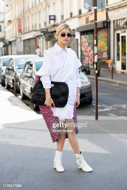 Digital influencer Caroline Daur wears all Masion Margiela on July 03, 2019 in Paris, France.