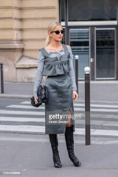 Digital influencer Caroline Daur wears all Miu Miu on March 03, 2020 in Paris, France.