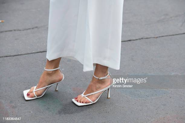 Digital influencer Caroline Daur wears Bottega Veneta shoes and Ellery trousers on September 25, 2019 in Paris, France.
