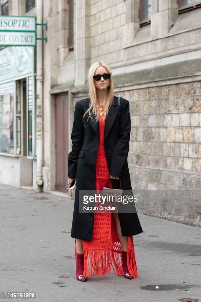 Digital Influencer Charlotte Groeneveld wears Balenciaga boots By Far bag Altuzarra jacket and dress and Celine sunglasses on March 02 2019 in Paris...