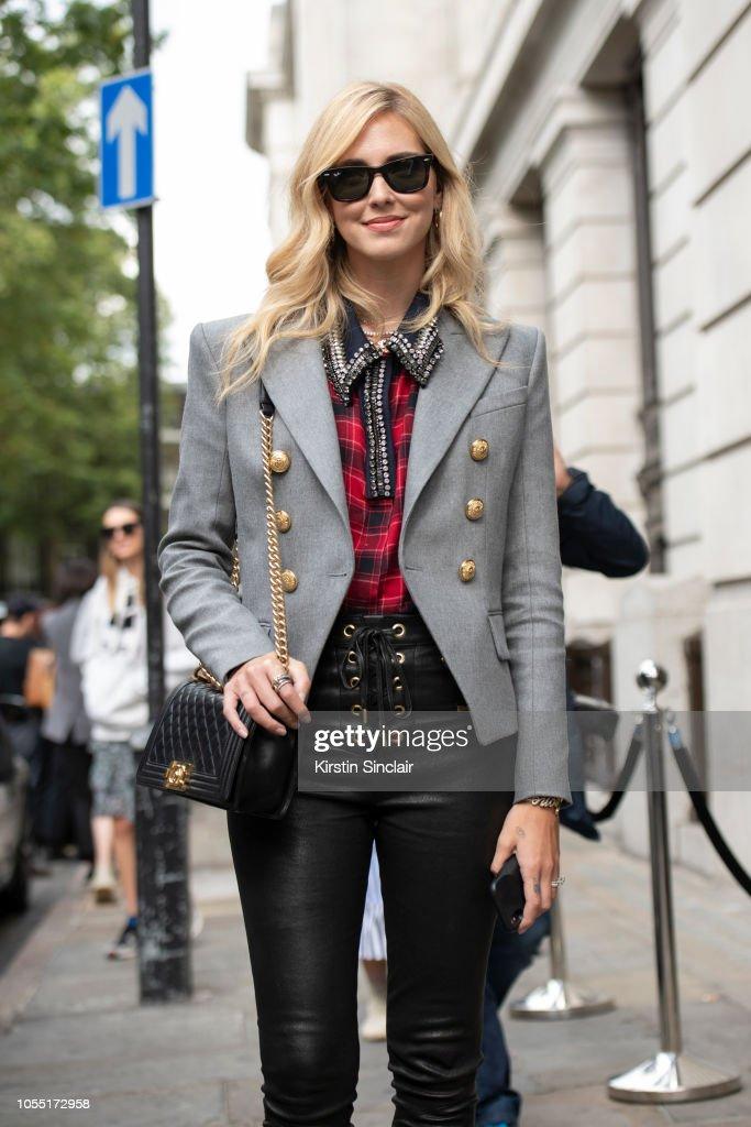 bce48e8278bd73 Digital Influencer Chiara Ferragni wears a Chanel bag, Ray Ban ...