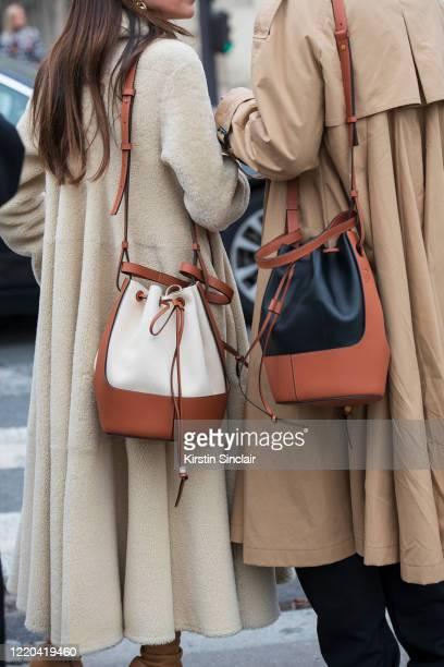 Digital influencer Chloé Harrouche of Loulou de Saison wears all Loewe with Digital influencer Linda Tol wearing a Loewe bag and coat on February 28,...