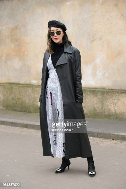 Digital Influencer Chriselle Lim of thechrisellefactor wears a Dior hat and dress Joshua Millard jacket and Roger Vivier boots day 2 of Paris Womens...