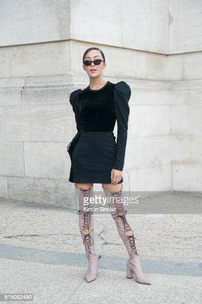 Digital influencer Chriselle Lim wears an Elie Saab dress Self Portrait boots and OffWhite sunglasses day 5 of Paris Womens Fashion Week...
