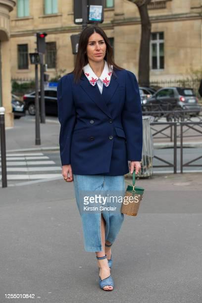 Digital influencer Deborah Reyner Sebag wears all Miu Miu with Prada shoes and a Nanuschka skirt on March 03, 2020 in Paris, France.