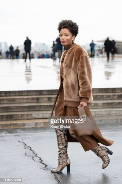 Digital Influencer Ellie Nesmon wears a Tibi coat and dress Danse Lente bag and Sam Edelman boots on March 02 2019 in Paris France