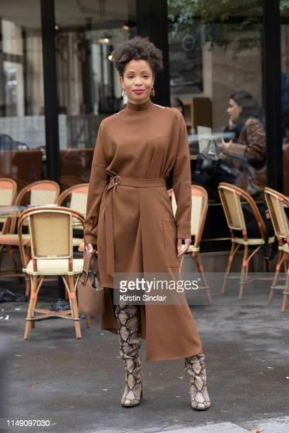 Digital Influencer Ellie Nesmon wears a Tibi dress Danse Lente bag and Sam Edelman boots on March 02 2019 in Paris France