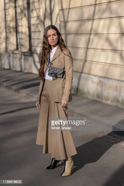 Digital Influencer Erika Boldrin wears a Dior skirt jacket shirt and bag with Celine boots on February 26 2019 in Paris France