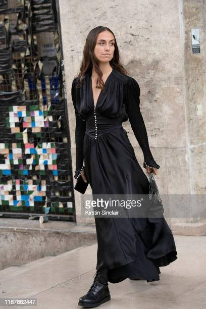 Digital influencer Erika Boldrin wears a Paco Rabanne dress and bag, The Row shoes on September 26, 2019 in Paris, France.