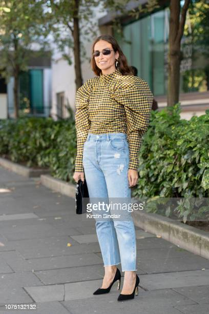 Digital Influencer Erika Boldrin wears a Rotate Birger Christensen top LuiJo jeans and Nicholas Kirkwood shoes during London Fashion Week September...