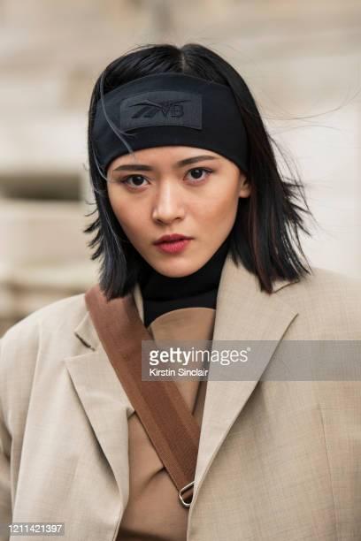 Digital Influencer Freya Sinyu Siu wears a Maison bent jacket and a black headband during London Fashion Week February 2020 on February 18 2020 in...