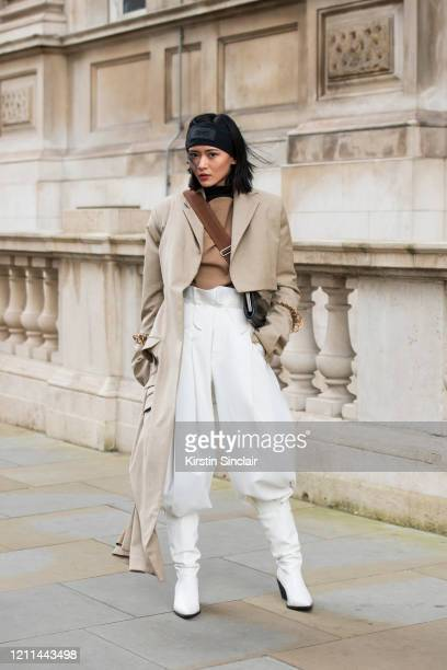 Digital Influencer Freya Sinyu Siu wears a Maison bent jacket Staff only top and trousers Topshop boots Victoria Beckham for Reebok headband and a...