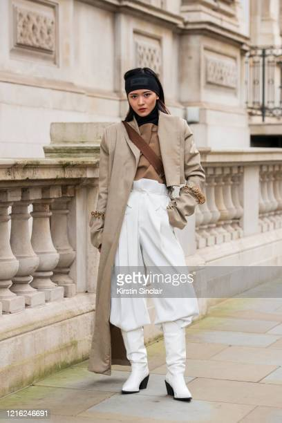 Digital Influencer Freya Sinyu Siu wears a Maison bent jacket Staff only top and trousers Topshop boots Victoria Beckham for Reebok headband and a...