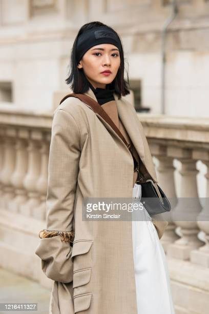 Digital Influencer Freya Sinyu Siu wears a Maison bent jacket Staff only top and trousers Victoria Beckham for Reebok headband and a YSL bag during...