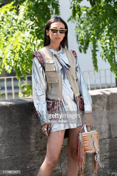 Digital Influencer Gabriella Berdugo wears a Tory Burch bag, Isabel Marant dress and Leonard waist coat on July 03, 2019 in Paris, France.