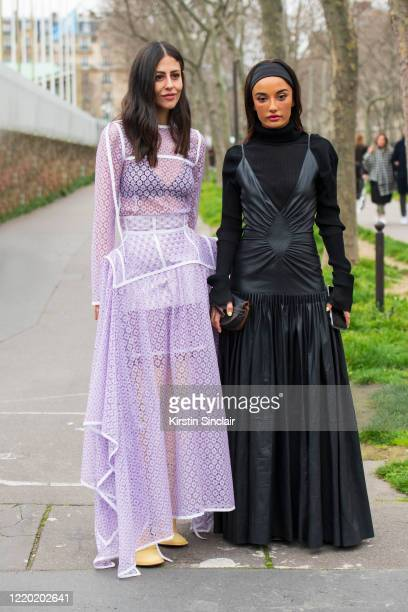 Digital influencer Gilda Ambrosio wears all Loewe with Shoe designer and digital influencer Amina Muaddi wearing all Loewe on February 28 2020 in...