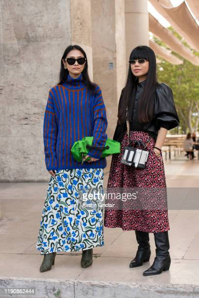 Digital influencer Hsinwei Ho wears a Boyy bag Zara shirt and shoes Etre Cecile skirt and For Art's Sake sunglasses with Digital influencer Pornwika...