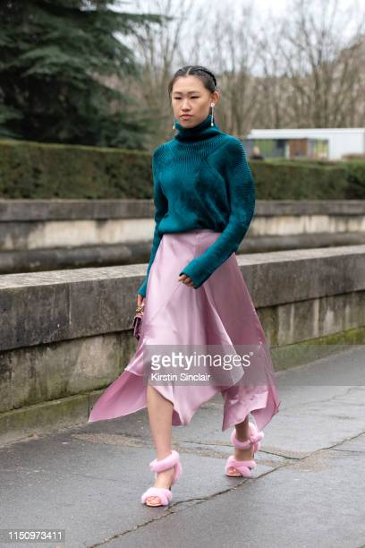 Digital Influencer Jaime Xie wears Valentino shoes, Miu Miu skirt and a Haider Ackermann jumper on March 03, 2019 in Paris, France.