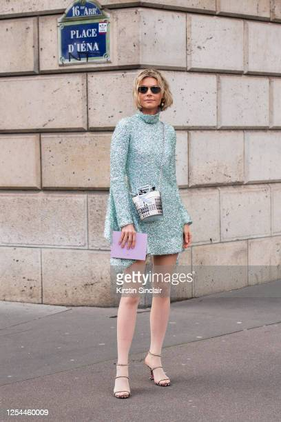 Digital influencer Kate Tik wears a Halpern Studio dress, Roger Vivier bag, Givenchy sunglasses, Falke tights and Amina Muaddi shoes on March 03,...